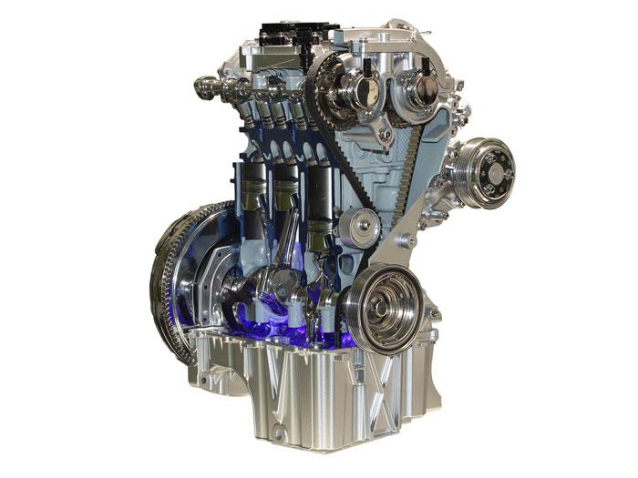 Una notable aportación de este motor es la de montar una correa dentada de distribución, pero bajo carcasa estanca en baño de aceite como las cadenas. Lo mejor de dos mundos: silencio y longevidad.