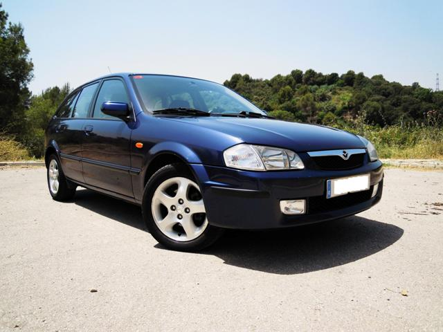 Mazda 323f (2001). Frontal